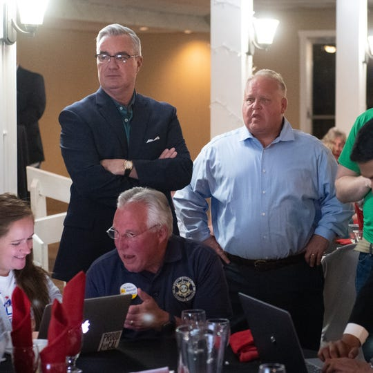 Ron Smith (right) and Chris Reilly (left) watch the results side-by-side on election night at a gathering of the Republican Party of York County, Tuesday, May 21, 2019 at Wisehaven.