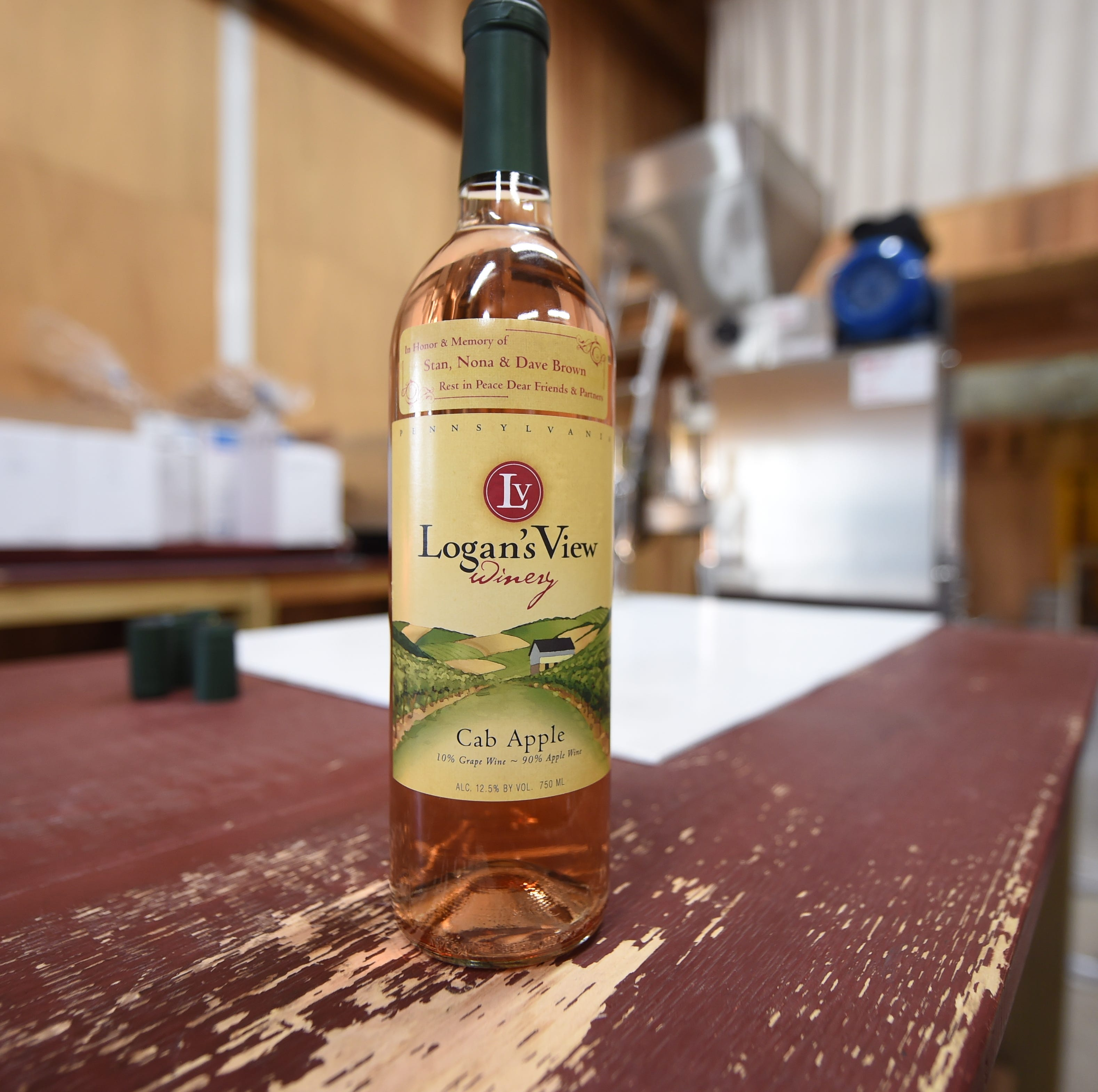 A bottle of Cab Apple from Logan's View Winery. The winery has produced a thousand bottles of the commemorative wine, a dollar of each bottle sold will be donated to the Dave Brown Music Scholarship in honor of the Brown family.