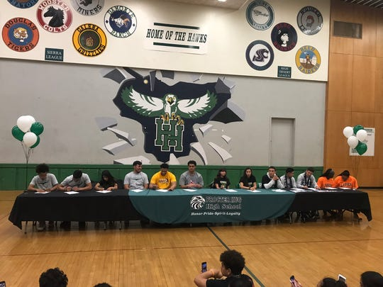 Hug High School had several students sign for college athletics in a ceremony at the school on Wednesday.