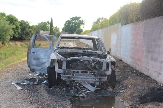 Christopher Wadstein's burned truck after it was extinguished by Sacramento Metro firefighters. Wadstein led police on two separate high-speed pursuits on May 21 after detectives tracked him down.