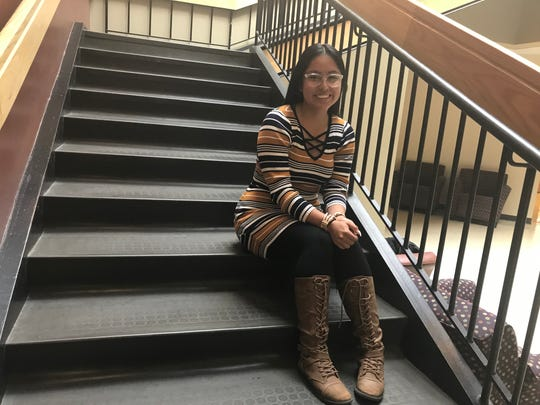 Ahtziry Vasquez, 17, sits on steps at Truckee Meadows Community College. She is one of 63 students graduating with a two-year degree from TMCC before she graduates high school. TMCC High is a dual enrollment program where students take college classes.