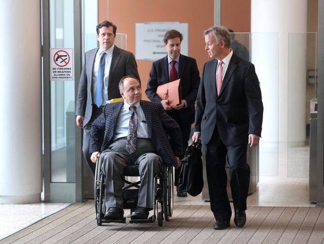 Developer Robert Morgan, second from left, leaves federal court in Buffalo after being charged with fraud and money laundering in May 2019.