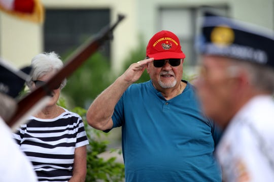 Joe Bellanca, who served in the Marine Corps, salutes the American flag during the 2018 Rochester Memorial Day parade.