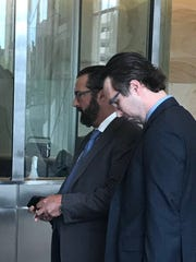 Frank Giacobbe, left, entering Buffalo federal court.