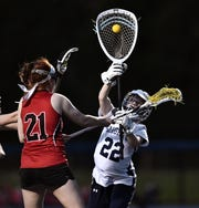 Brighton goalie Charlotte Sadler, right, stops a shot by Penfield's Celia Dow during a Class B sectional quarterfinal played at Brighton High School, Tuesday, May 21, 2019. No. 4 seed Brighton advanced to the Class B semifinal with a 13-4 win over No. 5 seed Penfield.
