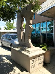 Graffiti is shown at the base of the military monument in front of the Shasta County Veterans Services Office on Shasta Street.