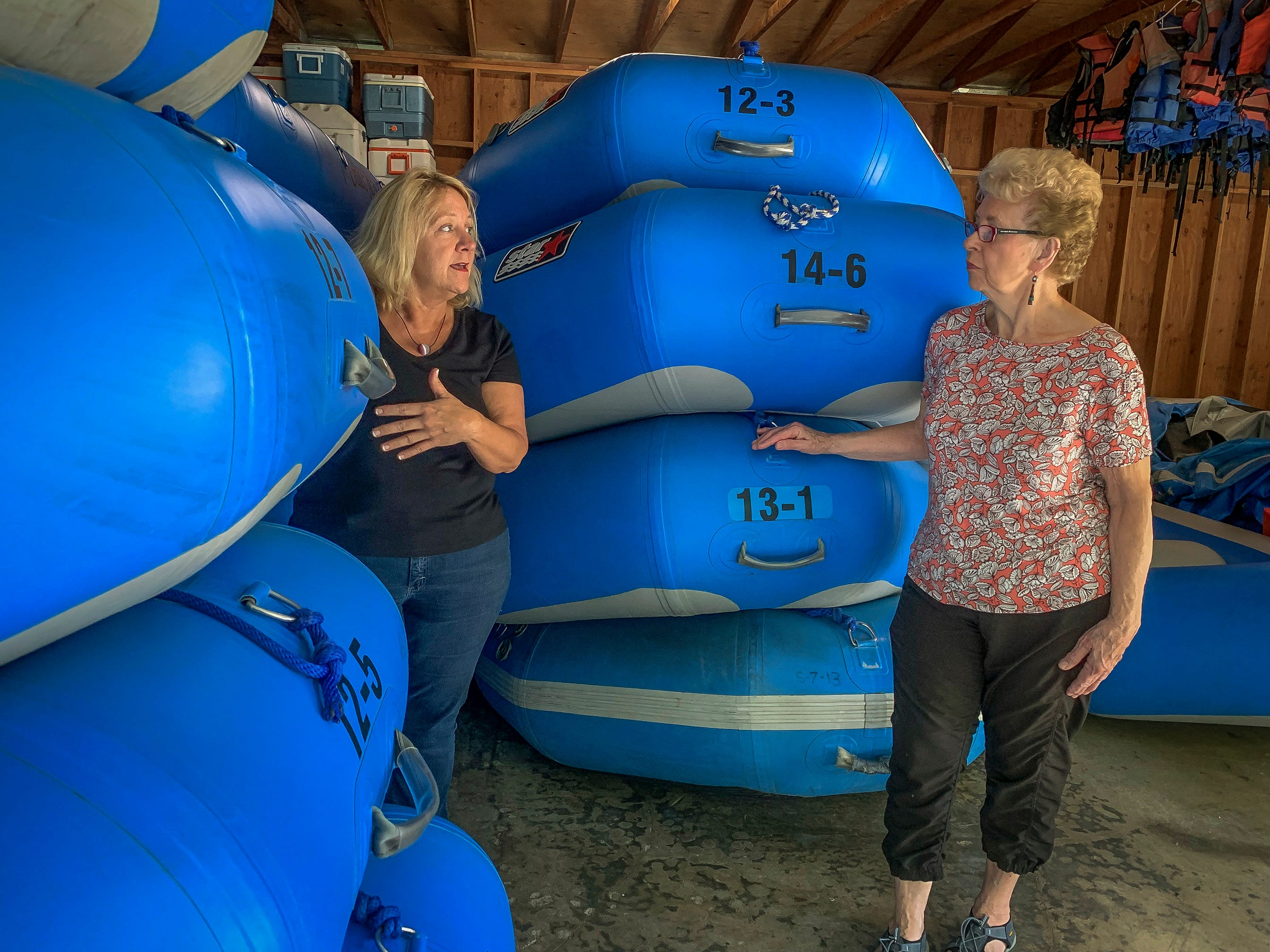 Debbie Thomason, left, and her mom, Mary Lou Thomason, work in the boathouse at the Galice Resort in Merlin, Oregon getting rafts ready for the beginning of their season along the Rogue River. The resort, owned by the Thomason family since the early 1980s, had to close its doors for over a week due to threat from wildfires in 2018. The popular destination lost revenue and had to lay off employees due to the closure.