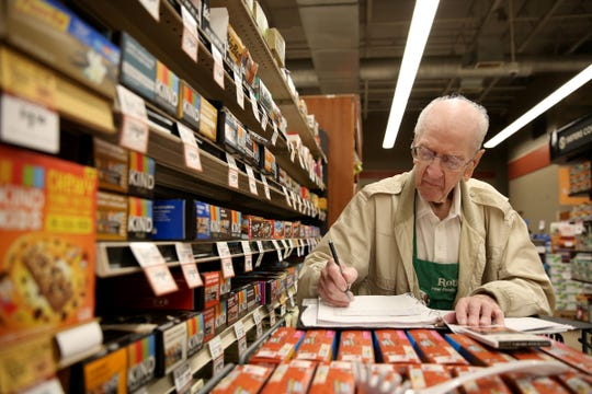 Robert Stone, 92, logs when items are near their expiration dates at the Roth's Fresh Markets at Hayesville in Salem on May 22, 2019. Stone has worked for Roth's for 25 years.