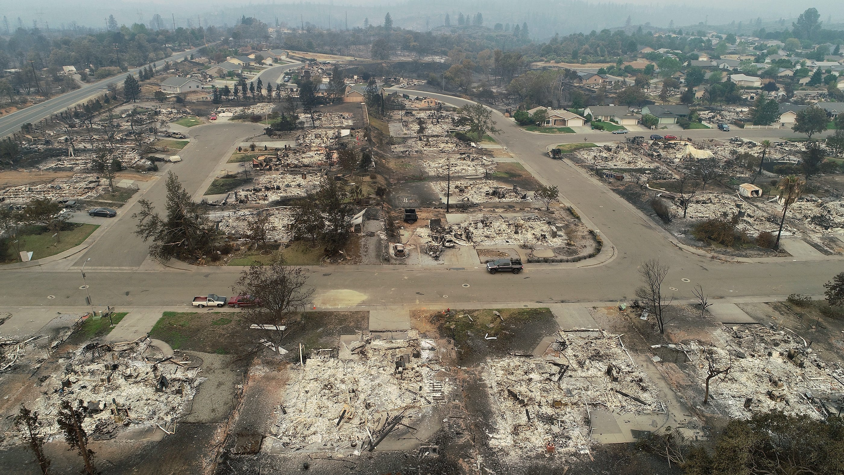 A view of the Lake Keswick Estates neighborhood on the northwest side of Redding, CA. This view from Menlo Way, with Cape Cod Drive at the right and Catalina Way to the left, looking west shows the devastation from the Carr Fire as it moved through the area.