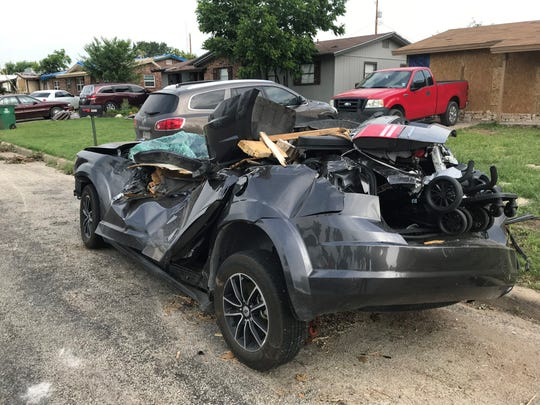A Dodge Journey is severely damaged on E. 24th Street Wednesday, May 22, 2019.