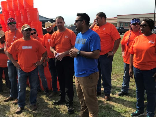 Sgt. Ali Shah speaks to volunteers ahead of a community cleanup on E. 24th Street Wednesday, May 22, 2019.