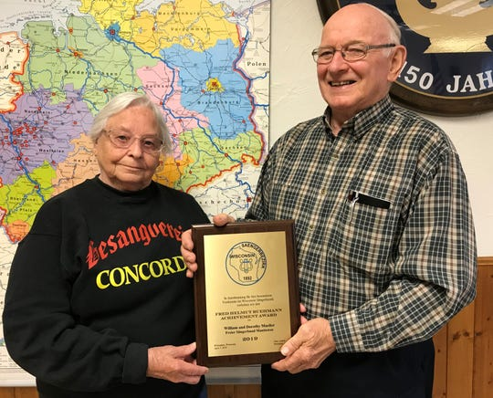 Bill and Dorothy Mueller with their award from the Wisconsin Saengerbezirk organization.
