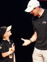 Jon Walker Scoggin shakes New Orleans Saints Quarterback and co-founder of Football N America Drew Brees's hand when he came to Shreveport to do a meet and greet with the parents and kids at LSUS Wednesday, May 22, 2019.