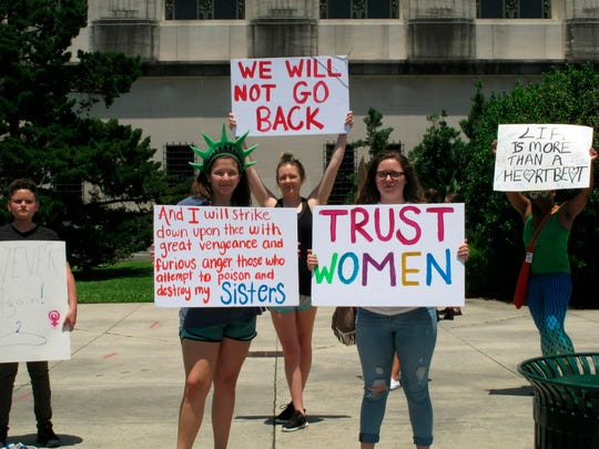 Abortion rights supporters protest at the Louisiana Capitol, where lawmakers are considering a bill that would ban abortion as early as six weeks of pregnancy, on Tuesday, May 21, 2019, in Baton Rouge, La. The bill is nearing final legislative passage.