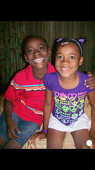 Pierre Lear and his sister, Ange-Laurette, pose for a photo at the orphanage they grew up at in Port-au-Prince.