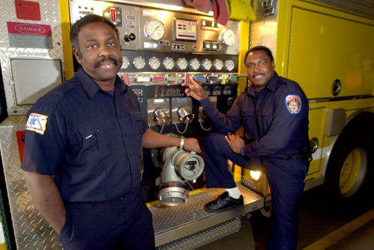 In this 1998 file photo, Ed Washington (left), is pictured after serving nearly 25 years on the Sioux Falls Fire Department. Washington was hired in 1975 and was Sioux Falls' first black firefighter. On the right, Ron Harris had been on the force 19 years. They both worked as fire apparatus operators.