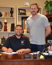 Matt Searson, chief academic officer of New Covenant Academy, on left, signed the education partnership agreement with Evangel University. With him is Mark Fabian, executive director of strategic partnerships and digital learning at Evangel.
