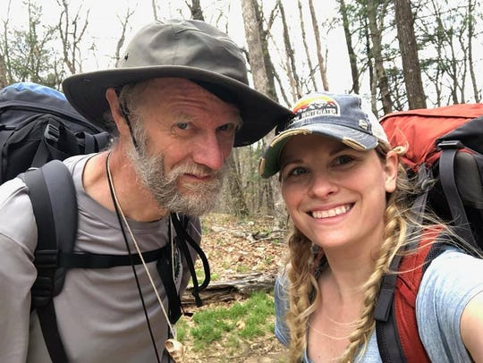 Joseph White and Heather Grow on the Appalachian Trail in Georgia. White owns Staunton's Cranberry's Grocery and Eatery while Grow is the store's manager. White has been hiking the trail since April and Grow joined him for the first two days of the adventure.