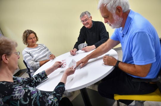 Sue Knauss, Roger Knauss , Jim Schnepf and Connie Nelson demonstrate a hand of bridge Wednesday, May 22, in St. Cloud. The local players recently won a regional tournament in Des Moines and will compete in Las Vegas this summer.