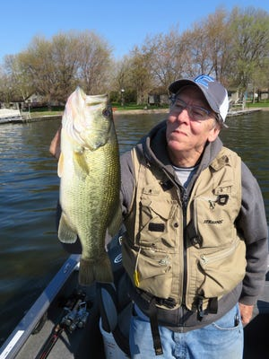 Brad Veenstra holds a nice bass that was caught on a wacky worm.