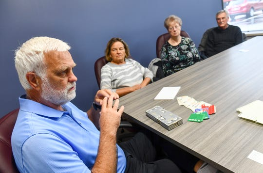 Jim Schnepf, Connie Nelson, Sue Knauss and Roger Knauss talk about their successes at competitive bridge during an interview Wednesday, May 22, in St. Cloud.