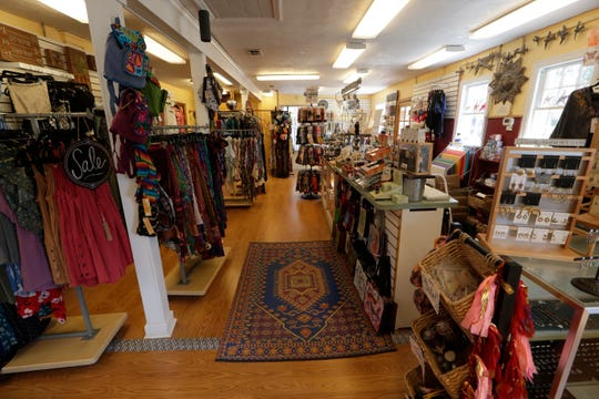 Quarter Moon Imports carries a wide variety of jewelry, clothing and gifts inside the Lake Ella cottage that has been in operation since 1989. Original owner Wendy Halleck is selling the business to her employee Katie Haggerty.