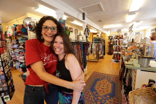 Wendy Halleck, left, opened Quarter Moon Imports in one of the Lake Ella Cottages in October of 1989. Katie Haggerty, right, has been working in the store for six years. Effective June 1, Haggerty will be the new owner of the clothing, jewelry and gift shop as Halleck retires.