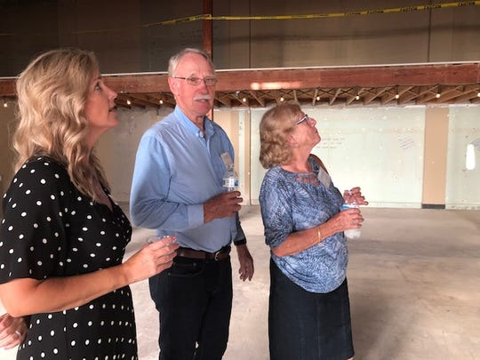 Buggy Bunch Executive Director Tara Wright (l.) shows off the interior structure of the old building to architect Staffan Lundberg and his wife Eva during a tour May 21, 2019. Lundberg is the architect who is designing the Family Education Center.