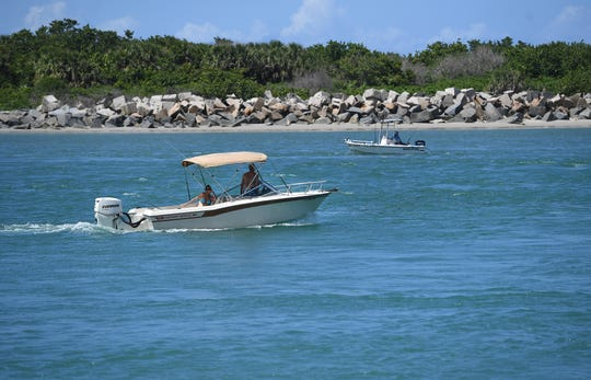 Recreational and sport fishing boaters share the waterway of the Fort Pierce Inlet on Monday, May 20, 2019, in Fort Pierce. Boat production is up, partly from red snapper fishing season being extended in the South Atlantic and the Gulf of Mexico.