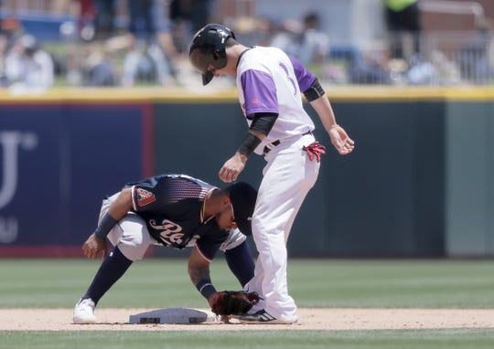 Reno second baseman Juniel Querecuto has fun with El Paso baserunner Luis Urias on a play that started as a steal attempt but ended as a walk.