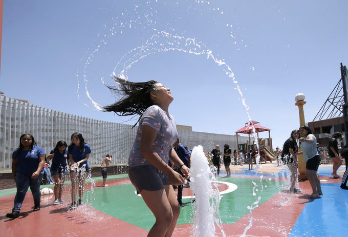 Aileen Ruiz from Eastwood Heights Elementary School cools down in the splash pad at Southwest University Park Wednesday duirng the team's final day game of the 2019 season.