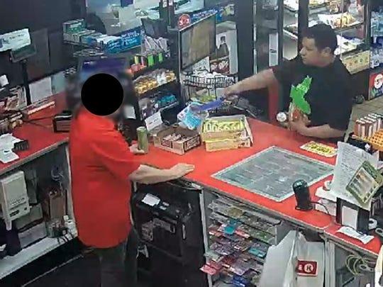 Surveillance still depicting an armed robbery in Santa Paula on April 14.