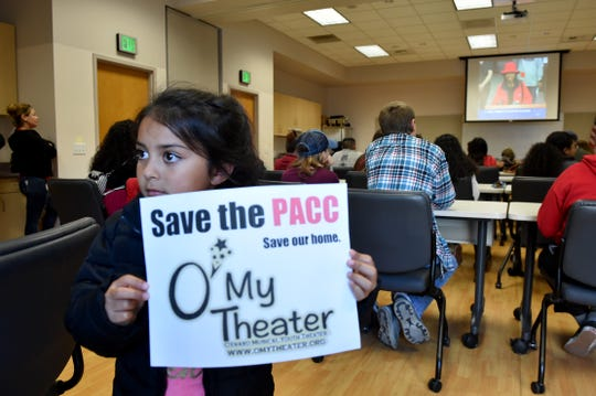 Catalina Perez-Angulo, 6, holds up a sign in an overflow room near Oxnard City Hall during a council meeting about budget cuts in May 2019. O'My Theater is a youth theater company that would like to use the Oxnard Performing Arts and Convention Center in January 2020 but the likelihood is slim.