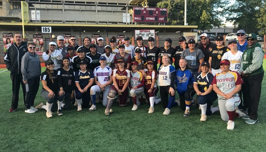 Players and coaches from the second annual Ventura County senior all-star softball game pose for a photo after the game ended in a 5-5 tie on Tuesday afternoon at Oaks Christian.