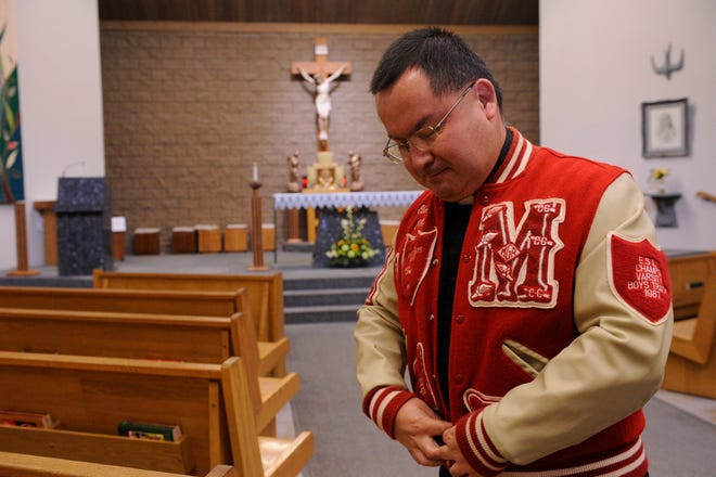 in this file photo, Rev. Raul Diaz wears his letterman jacket from McFarland High School where he graduated from in 1987.