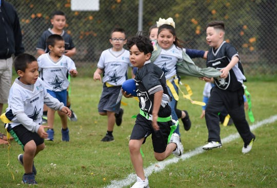 Sheriff Mike Boudreaux opened the new NFL Flag Football League at Ivanhoe Elementary School with a Community Carnival and the Parade of Teams on March 23, 2019.