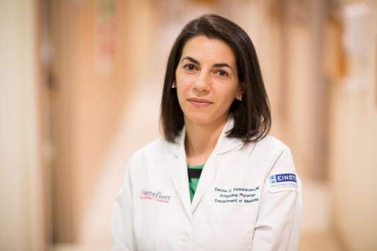 Dr. Denisa E. Ferastraoaru, M.D.