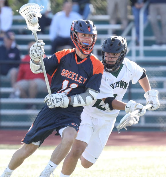 Yorktown's Keith Boyer (13) guards Greeley's Harris Allen (11) during boys lacrosse Section 1 Class B semifinal game at Yorktown High School May 21, 2019. Yorktown defeats Greeley 15-6.