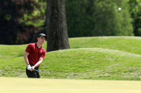 Jay Allen of Scarsdale gets the ball on the 12th green during the final round of the Section 1 boys golf tournament at Fenway Golf Club May 22, 2019 in Scarsdale.