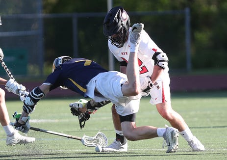 Rye's  Brendan Lavelle (32) and Pelham's Dane Crowley (7)  battle for ball control during boys lacrosse playoff action at Rye High School May 21, 2019. Rye won the game 16-3.