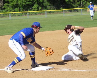 Mahopac's Nick Mancusi prepares to tag out Clarkstown South's Jack Addeo, who was caught trying to steal during his team's 3-0 victory in a Section 1 baseball playoff game on May 21, 2019.