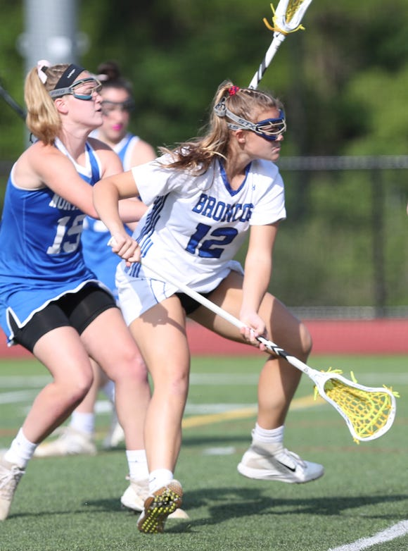 Bronxville's Hanna Bishop (12) fires a shot for a first half goal against North Salem during the girls lacrosse championship game at Fox Lane High School in Bedford May 22, 2019. Bronxville won the game.