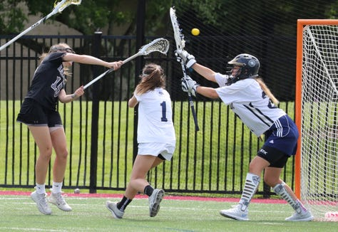 Hackley's Maddie White scores past Rye Country Day goalie Kat Brydson during the NYSAIS championship girls lacrosse game at Manhattanville College May 22, 2019. Hackley won 18-7.