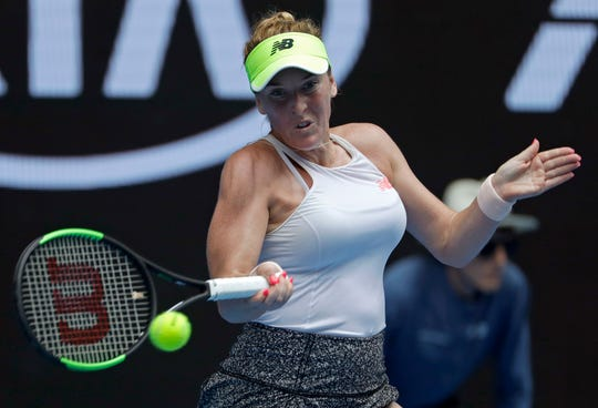 Delaware native Madison Brengle makes a forehand return to Karolina Pliskova of the Czech Republic during their second round match at the Australian Open tennis championships in Melbourne, Australia, Thursday, Jan. 17, 2019.