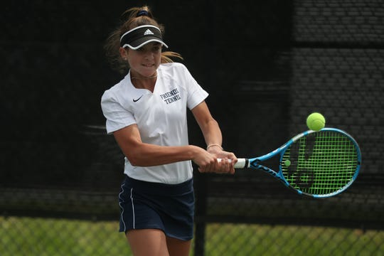 Wilmington Friends Aubrey Nisbet in action in the DIAA girls first singles championship Wednesday at St. Andrew's. Nisbet defeated Dover's Erika Synoski 6-1, 6-4.