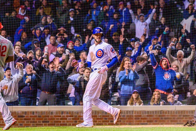 May 21, 2019; Chicago, IL, USA; Chicago Cubs third baseman Kris Bryant (17) reacts after scoring during the ninth inning against the Philadelphia Phillies at Wrigley Field. Mandatory Credit: Patrick Gorski-USA TODAY Sports