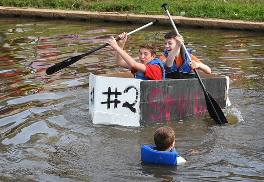 About 300 Barwise Middle School eighth graders built about 60 boats using only cardboard, masking tape, caulk and paint as part of their Science class. The project helped teach them about floatation, bouancy and Newton's Laws of Motion.