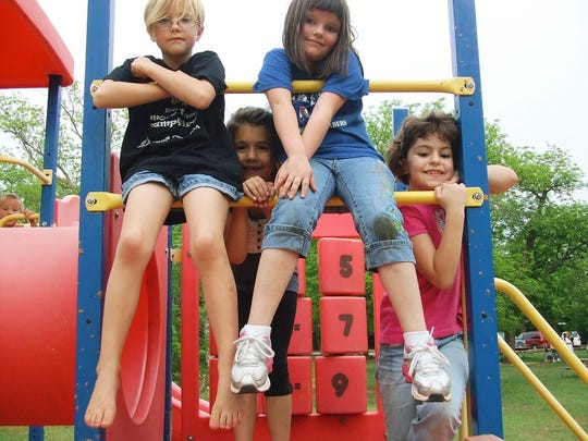 Camp Fire participants are seen on the playground. Camp Fire is open for summer day camps beginning June 3.
