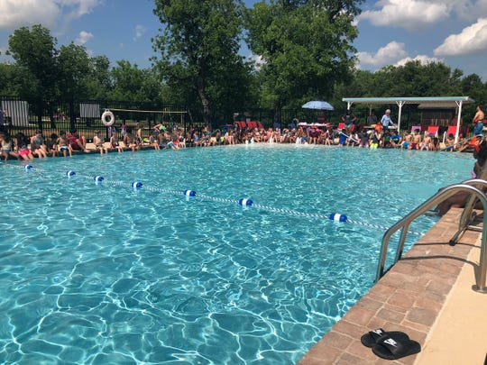 Swimmers are seen at the Harrell Park pool at Camp Fire North Texas. The pool is open for members and nonmembers and will have a free swim day Saturday.