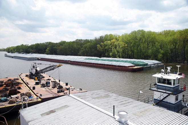 In this Tuesday, May 14, 2019 photo, barges already loaded with soy beans, potash or scrap steel await movement on the Mississippi River in St. Paul, Minn., as spring flooding interrupts shipments on the river. Historic Midwest flooding that began in March has left parts of the Mississippi River closed for business.